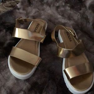 Brand new soda sandals in gold. Size 7.5